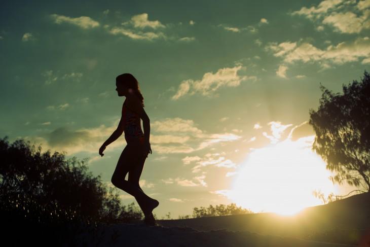 Silhouette of girls walking at sunrise